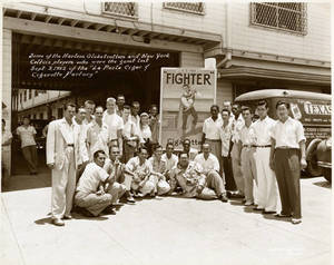 Harlem Globetrotters at the La Perla Cigar and Cigarette Factory in Paranaque, Philippines on September 3, 1952