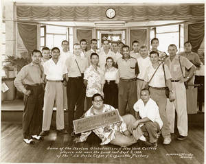 The Harlem Globetrotters at the La Perla Cigar and Cigarette Factory in Paranaque, Philippines on September 3, 1952.