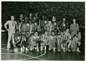 A photograph of the Harlem Globetrotters and the New York Celtics on a basketball court, 1952