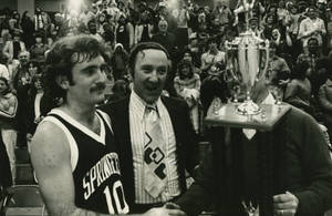 Awarding a trophy to Springfield College Basketball team