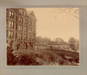 Working on the grounds outside the Springfield College dormitory, ca. 1898