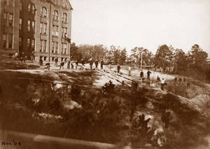 Working on the grounds outside the dorm in November 1898