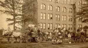 Workers outside the Dormitory Building, 1897