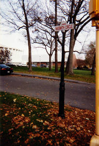 James Naismith Circle sign outside the Blake Arena and Physical Education Complex, ca. 1990-2000