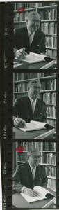 Contact sheet of Dr. Seth Arsenian with book