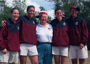 Coach Diane Potter surrounded by softball team members
