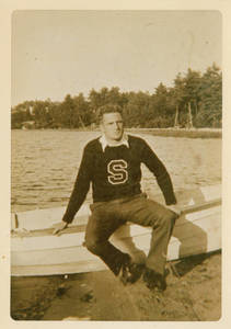 A young Charles E. Silvia sitting on boat