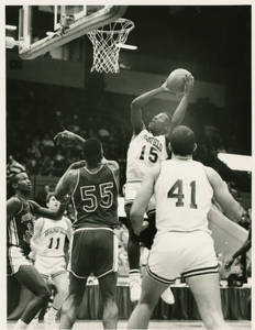 SC Basketball player, Ramses Kelly, taking a shot from under the hoop