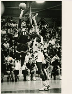 SC Basketball player, Ramses Kelly, taking a shot over a defender