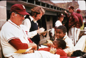 Archie Allen in the dugout with kids