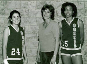 Lucille Kyvallos with two basketball players