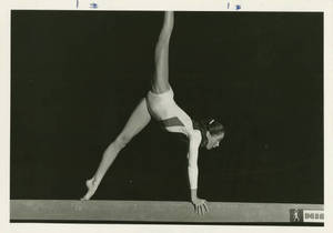 Joan Carey performing on the balance beam