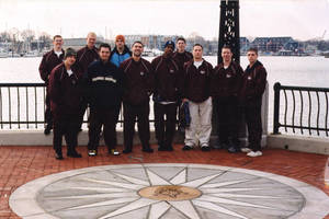 Springfield College men's gymnastics team group photograph by the water