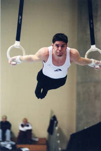 Springfield College male gymnast on rings at USGF Championship (April, 2001)