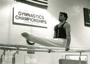 Keith R. LaChance on the parallel bars