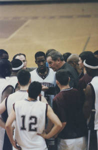 Coach Brock talking to players during a game (2000)
