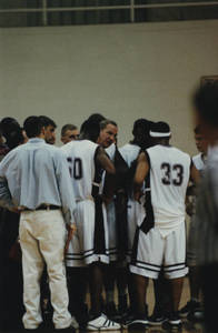 Springfield College Men's Basketball team in a huddle (2000)