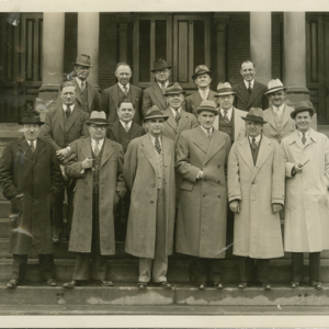 Anthony J. Stonina - standing with others on the steps of City Hall