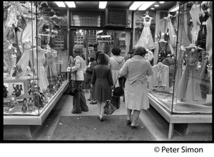 Shoppers at the entrance to a women's apparel store