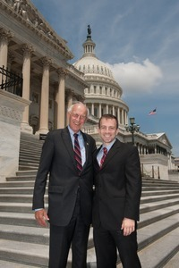 Congressman John W. Olver (center) with unidentified man, posed on the steps of the United States Capitol building