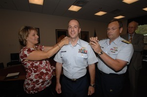 Commander Mark Fedor (center), US Coast Guard, being sworn in as Special Detailee to House Appropriations Committee