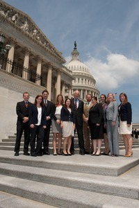 Congressman John W. Olver (center) with visiting group, posed on the steps of the United States Capitol building