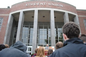 Congressman John W. Olver in front of the UMass Amherst Student Union Building, waiting to speak to rally against student loan debt