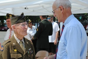 Congressman John W. Olver: portrait, talking with an veteran of the 8th Air Force, World War II