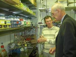 Congressman John W. Olver in the laboratory with Derek Lovely (Microbiology, UMass Amherst)