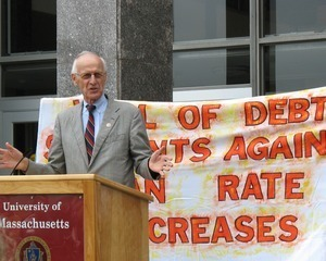 Congressman John W. Olver in front of the UMass Amherst Student Union Building, speaking at a rally against student loan debt