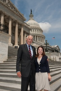 Congressman John W. Olver (center) with unidentified woman, posed on the steps of the United States Capitol building