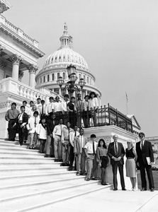 Congressman John W. Olver (3d from right) with visiting group, posed on the steps of the United States Capitol building
