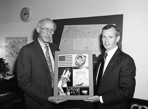 Congressman John W. Olver (left) presented with an flag and crew patch flown aboard the Orbiter Atlantis by the crew of Shuttle Mission ST-45