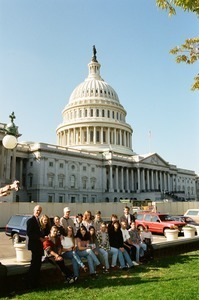 Congressman John W. Olver and group of visitors, posed in front of the United States Capitol building