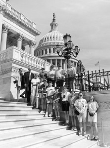 Congressman John W. Olver (2d from left) with group of visitors, posed on the steps of the United States Capitol building