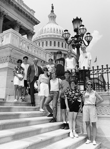 Congressman John W. Olver (3d from left) with group of visitors, posed on the steps of the United States Capitol building