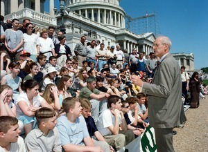 Congressman John W. Olver addressing of visitors seated on the steps of the United States Capitol building