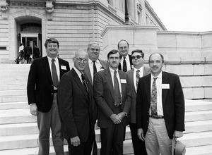 Congressman John W. Olver (2d from left) with group of visitors from Massachusetts corporations, posed on the steps of the United States Capitol building