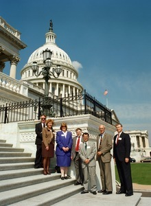 Congressman John W. Olver and group of visitors, posed on the steps of the United States Capitol building