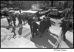 Jack Kerouac's funeral: pallbearers carrying casket down church steps, Allan Ginsberg center-right, Jeff Albertson with camera on right