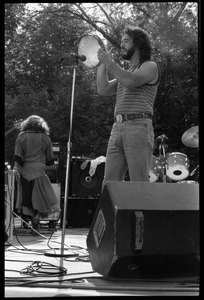 Airto Moreira on tambourine, Flora Purim (back to camera), and band performing at Jazz Festival, Hampshire College