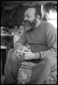 Andrew Salkey: three-quarter length portrait seated, with cigarette