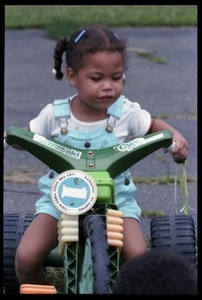 Zena Allen on a tricycle