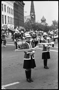Women performing with drill team and drum line, corner of Main Street and Crafts Ave.