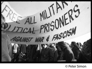 Protesters beneath a banner 'Free all military political prisoners... against war & fascism' (re. Fort Dix antiwar soldiers): Vietnam Moratorium march on Washington
