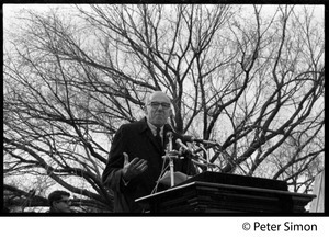 Benjamin Spock speaking at the podium: Vietnam Moratorium march on Washington