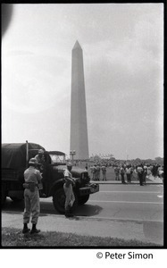 National guardsmen and truck at the ready during the March on the Pentagon (mobilization on Washington), the Washington Monument in the background