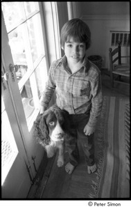 Young boy with a spaniel