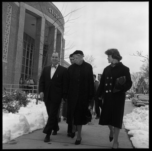 Eleanor Roosevelt (center) walking past the Student Union building with John Gillespie (left) and Gail Osbaldeston (right), during Roosevelt's Distinguished Visitors Program appearance