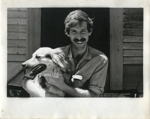 Jim Aaron, holding a dog, Montague Farm Commune